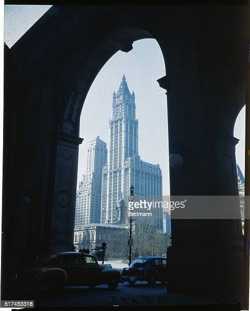 New York City City Hall Woolworth Building and the Transportation Building are shown through a building's arch