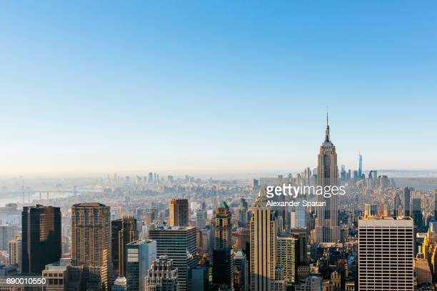 new york city cityscape in the morning with clear blue sky - new york skyline stock photos and pictures