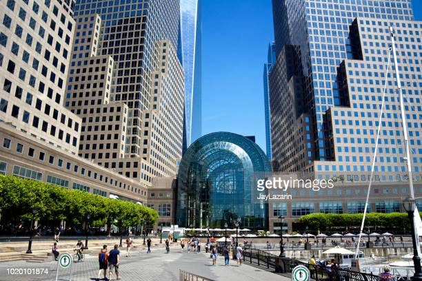 new york city cityscape, public park at the winter garden atrium and one world trade center, lower manhattan, usa - world financial center new york city stock pictures, royalty-free photos & images