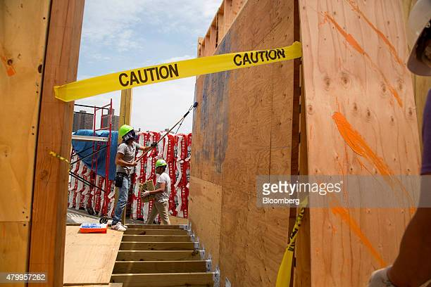 New York City College of Technology undergraduate students work on a house for the US Department of Energy Solar Decathlon 2015 in the Brooklyn...