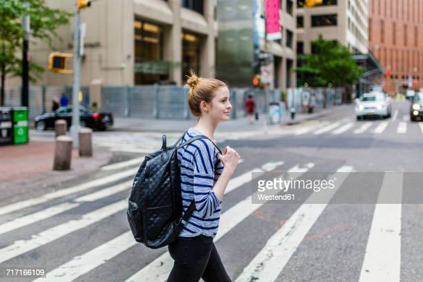 USA, New York City, confident woman walking on the streets of Manhattan
