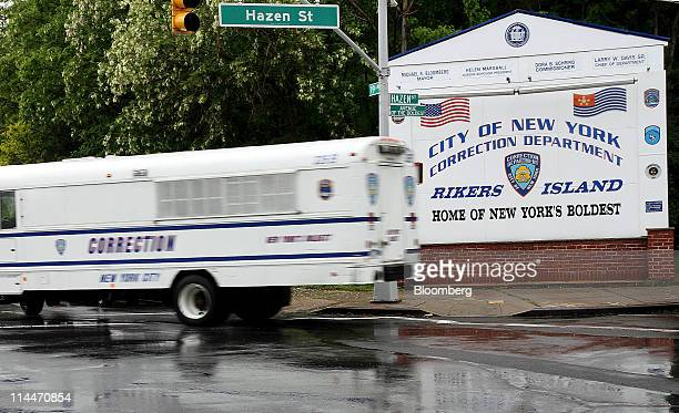 A New York City Corrections bus turns off of the Rikers Island entry road in New York US on Friday May 20 2011 Dominique StraussKahn former managing...
