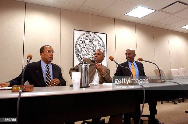 New York City Council Deputy Majority leader Bill Perkins sits with attorneys Michael Warren and Roger Wareham at a news conference on the Central...
