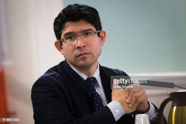 New York City Council member and chairman of the Committee on Immigration Carlos Menchaca looks on during a committee hearing concerning the...