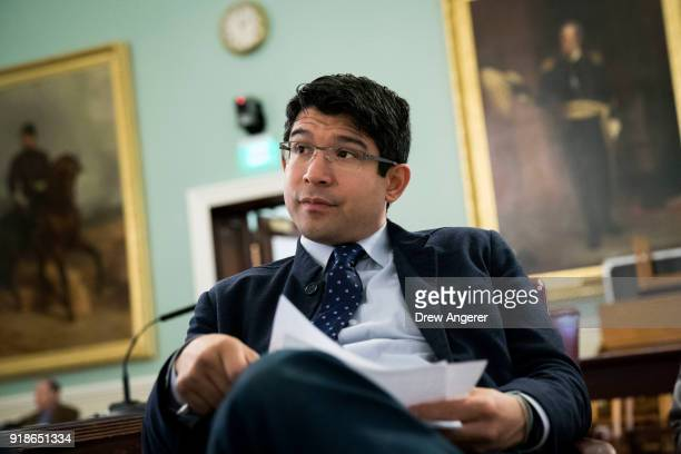 New York City Council member and chairman of the Committee on Immigration Carlos Menchaca goes over notes before the start of a committee hearing...
