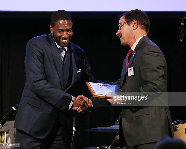 New York City Council Member Jumaane D Williams receiving the NYAGV Founders Award from board member Paul May at the New Yorkers Against Gun Violence...