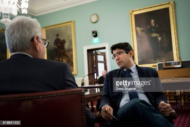 New York City council member Robert F Holden speaks with New York City Council member and chairman of the Committee on Immigration Carlos Menchaca...