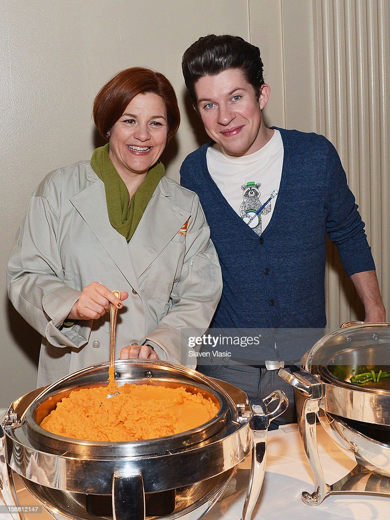 New York City Council Speaker Christine Quinn and chef Justin Warner volunteer during the Our Table Is Yours - A Thanksgiving Day benefit at Cipriani, Wall Street on November 21, 2012 in New York City.