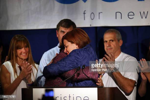 New York City Council Speaker Christine Quinn is hugged by her wife Kim Catullo while giving her concession speech in the New York Democratic mayoral...