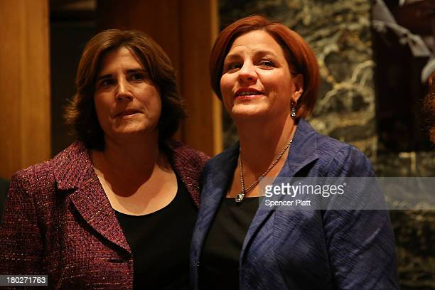 New York City Council Speaker Christine Quinn stands backstage with her wife Kim Catullo moments before conceding defeat in the New York Democratic...