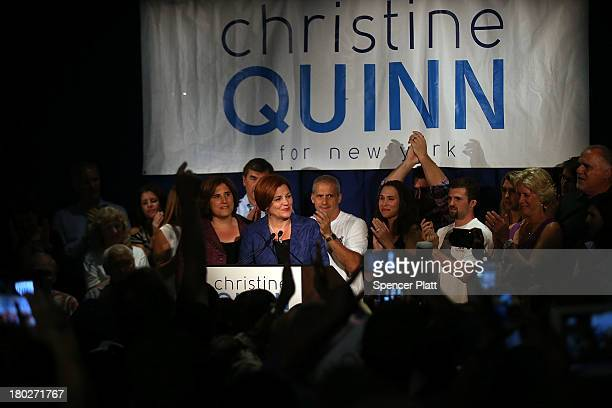 New York City Council Speaker Christine Quinn stands with her wife Kim Catullo while giving her concession speech in the New York Democratic mayoral...