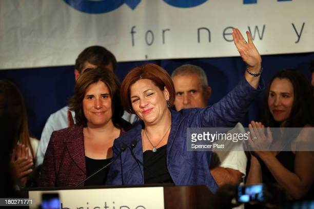 New York City Council Speaker Christine Quinn waves with her wife Kim Catullo while giving her concession speech in the New York Democratic mayoral...