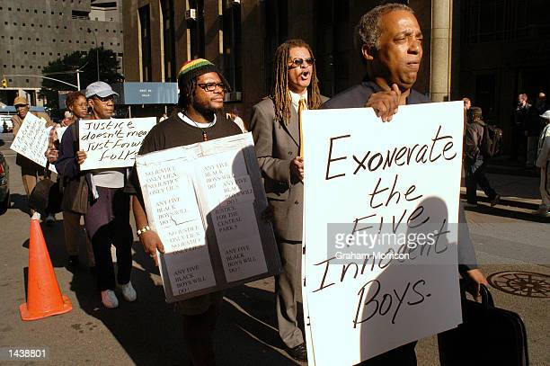 New York City Councilman Charles Barron from Brooklyn's district 42 leads a protest outside of Manhattan's Criminal Court September 30 2002 in New...