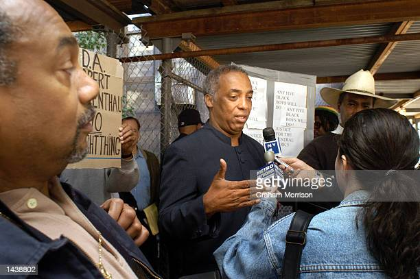 New York City Councilman Charles Barron from Brooklyn's district 42 speaks to reporters outside of Manhattan's Criminal Court September 30 2002 in...