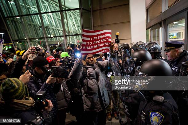 New York City Councilman Jumaane Williams center joined demonstrators protesting outside John F Kennedy International Airport against US President...