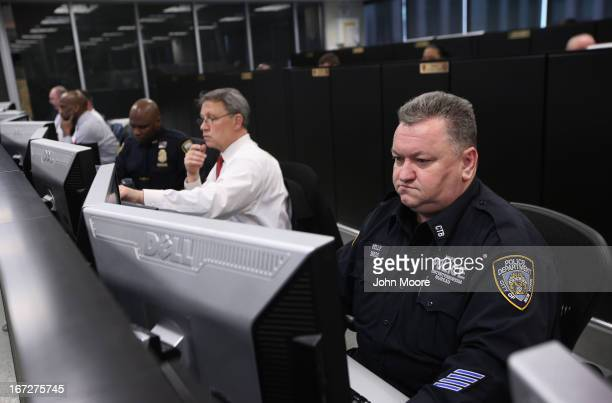New York City counterterrorism police and private security personel monitor cameras at the Lower Manhattan Security Initiative on April 23 2013 in...