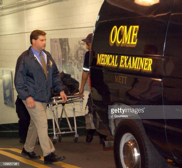 New York City Crime Scene Investigators stand by as officials from the medical examiners office prepare to transport the body of Eric Douglas Eric...