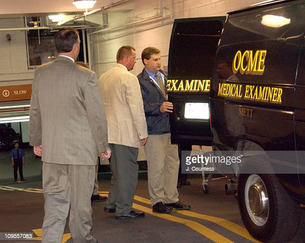 New York City Crime Scene Investigators stand by as officials from the medical examiners office load the body of Eric Douglas into Medical Examiners...