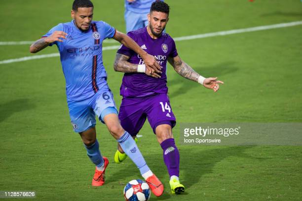 New York City defender Alexander Callens and Orlando City forward Dom Dwyer fight for the ball during the soccer match between NYCFC and Orlando City...