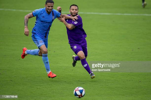 New York City defender Alexander Callens and Orlando City midfielder Josue Colman fight for the ball during the soccer match between NYCFC and...