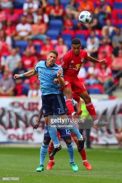 New York City defender Ben Sweat battles New York Red Bulls midfielder Tyler Adams for a head ball during the second half of the Major League Soccer...