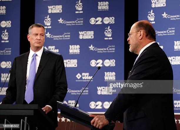 New York City Democratic mayoral candidate Bill de Blasio listens as New York City Republican mayoral candidate Joe Lhota speaks during the debate on...