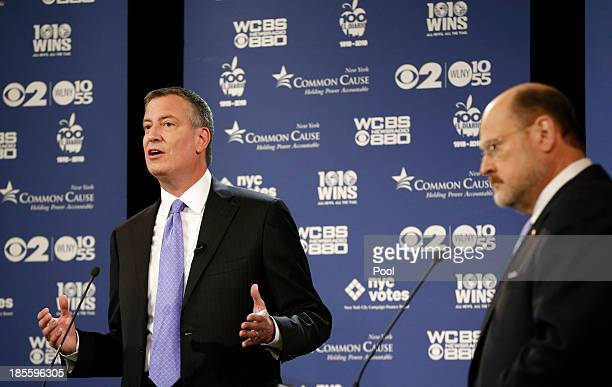 New York City Democratic mayoral candidate Bill de Blasio makes a point as New York City Republican mayoral candidate Joe Lhota listens on October 22...