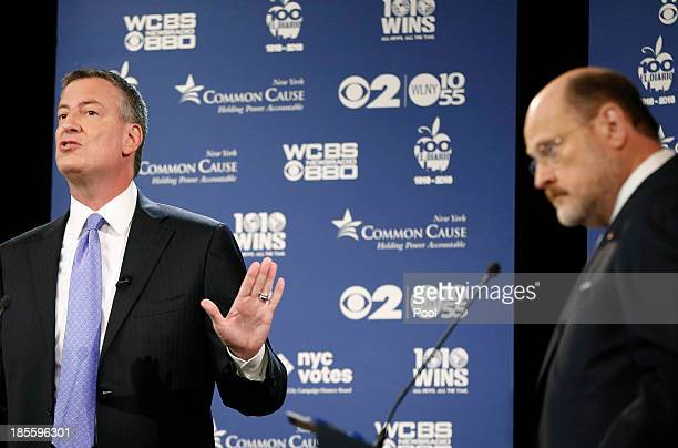 New York City Democratic mayoral candidate Bill de Blasio raises his hand as he makes a point while New York City Republican mayoral candidate Joe...