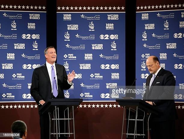 New York City Democratic mayoral candidate Bill de Blasio speaks as New York City Republican mayoral candidate Joe Lhota looks on during the debate...