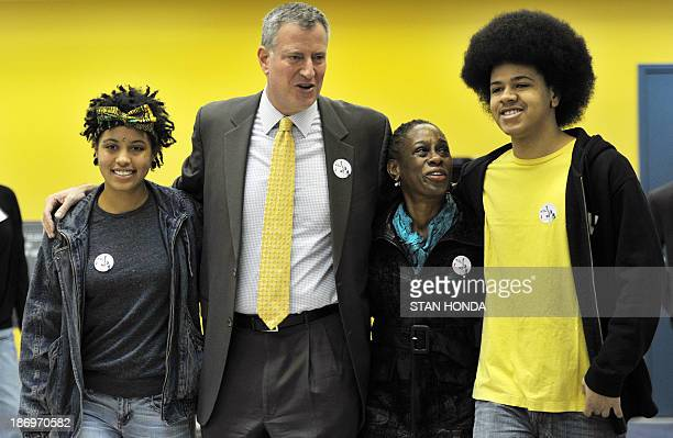 New York City Democratic mayoral candidate Bill de Blasio with his wife Chirlane McCray daughter Chiara and son Dante after voting at the Park Slope...