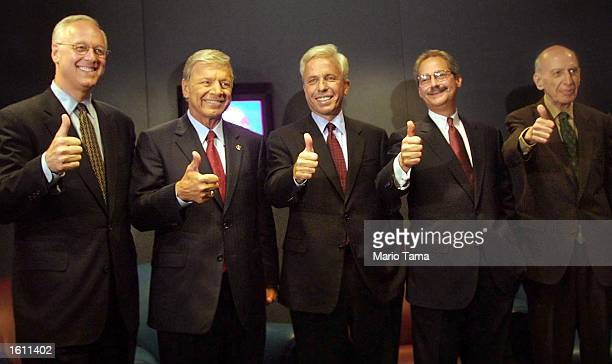 New York City Democratic Mayoral candidates Alan Hevesi Peter Vallone Mark Green Fernando Ferrer and George Spitz pose for photographers after...