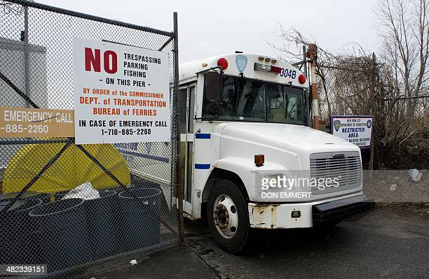 A New York City Department of Corrections bus leaves the City Island Ferry Station March 28 2014 in New York The Department of Corrections is...