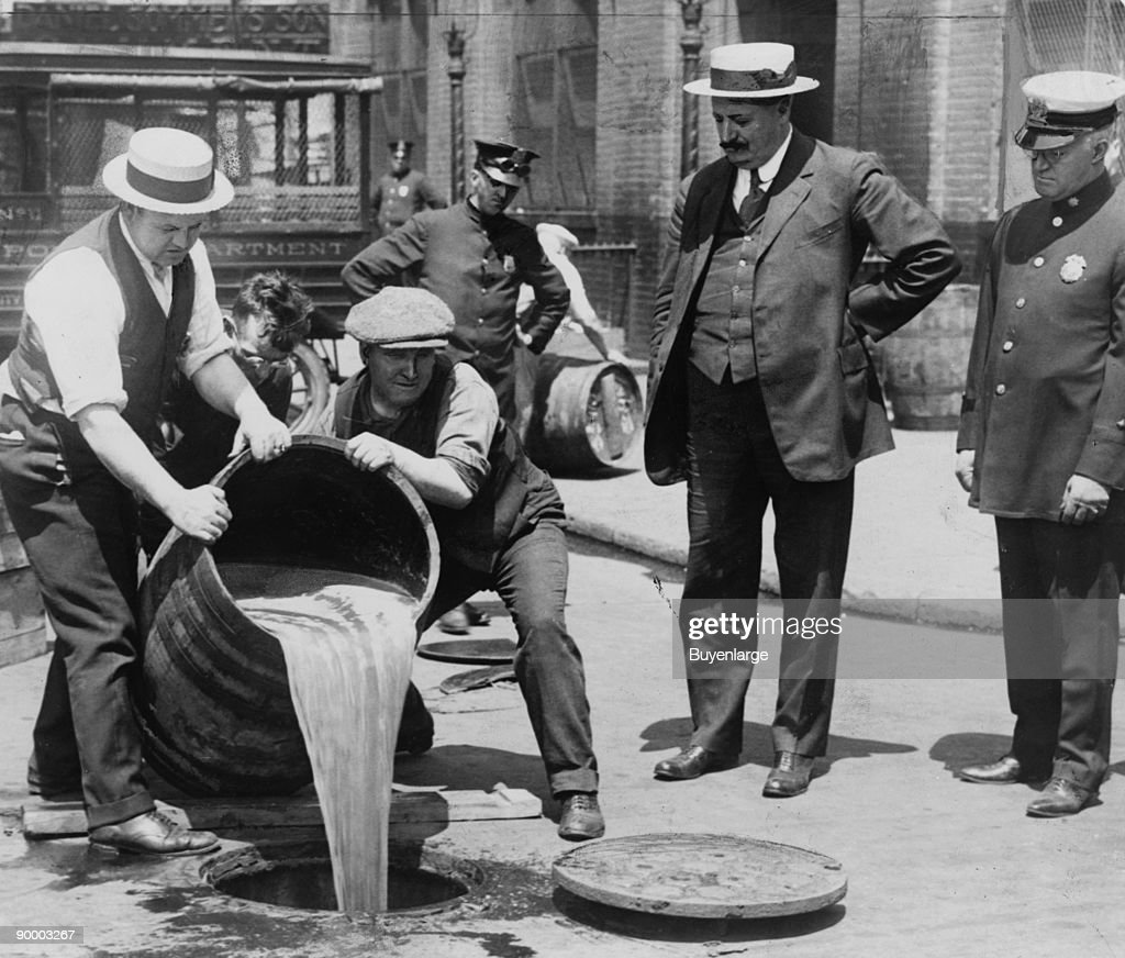 Pouring out illegal alcohol into a Sewer : News Photo