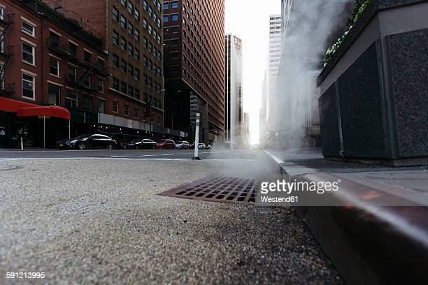 usa, new york city, downtown manhattan, haze coming out of a gully in the morning - curb stock pictures, royalty-free photos & images