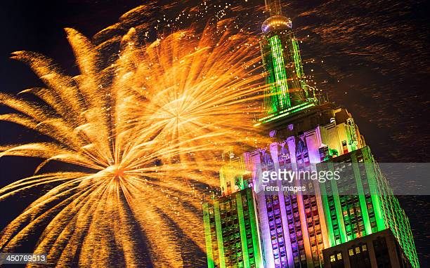 USA, New York City, Empire state building with firework display