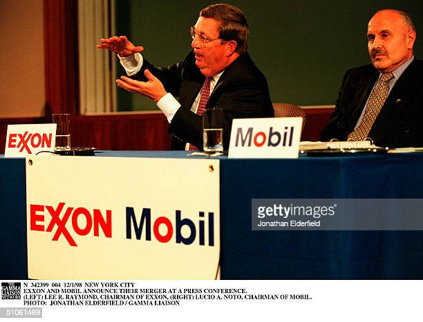 New York City Exxon And Mobil Announce Their Merger At A Press Conference Lee R Raymond Chairman Of Exxon Lucio A Noto Chairman Of Mobil