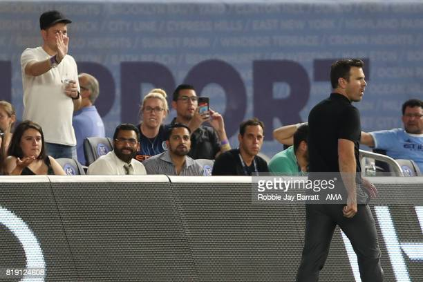 New York City fan waves at Greg Vanney head coach / manager of Toronto FC as he is send off during MLS fixture between Toronto FC and New York City...