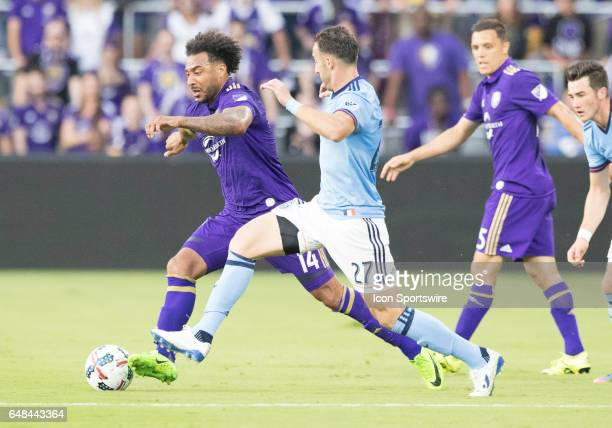 New York City FC defender RJ Allen and Orlando City FC G Barnes challenge side by side during the MLS soccer match between the Orlando City FC and...