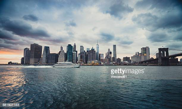USA, New York City, ferry on East River and skyline