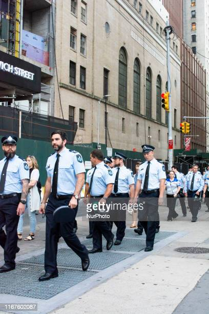 New York City fire Department members march down Greenwich Street the main entrance to the 9/11 Ceremony
