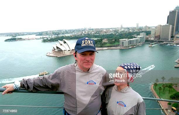 New York City firefighter Bob Merkel from Ladder Co 42 in the South Bronx along with his girlfriend Marlene de Souza climb the Sydney Harbor Bridge...