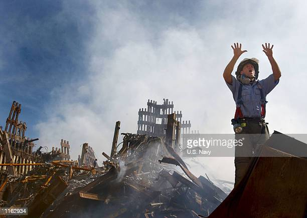 New York City fireman calls for 10 more rescue workers to make their way into the rubble of the World Trade Center September 14 2001 days after the...