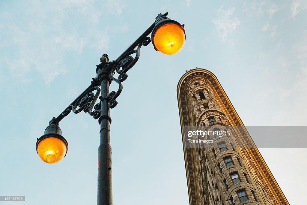 USA, New York City, Flatiron building with street lamp : Stock Photo