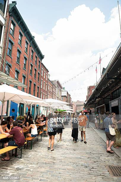 new york city front street outdoor city street scene - south street seaport stock pictures, royalty-free photos & images