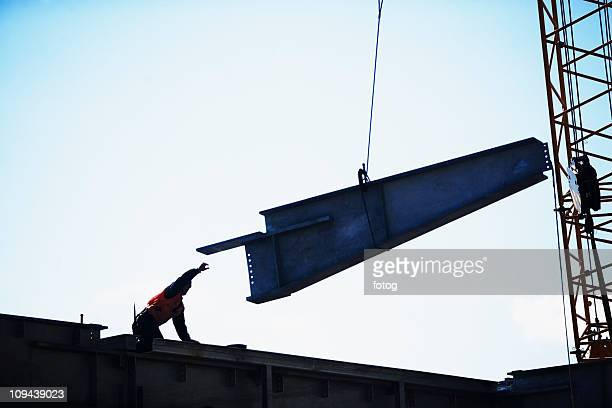 USA, New York City, girder being lifted at construction site