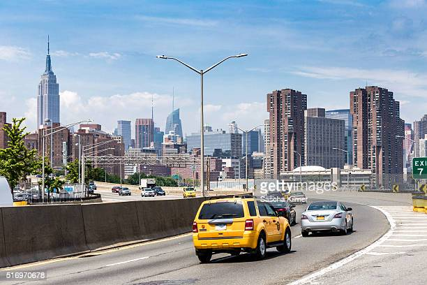 New York City, Highway with Empire State Building in the background.