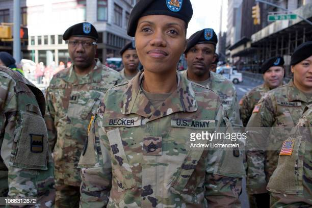New York City hosts its annual Veteran's Day parade as crowds watch troops national guard units military academies and ROTC programs march up 5th...