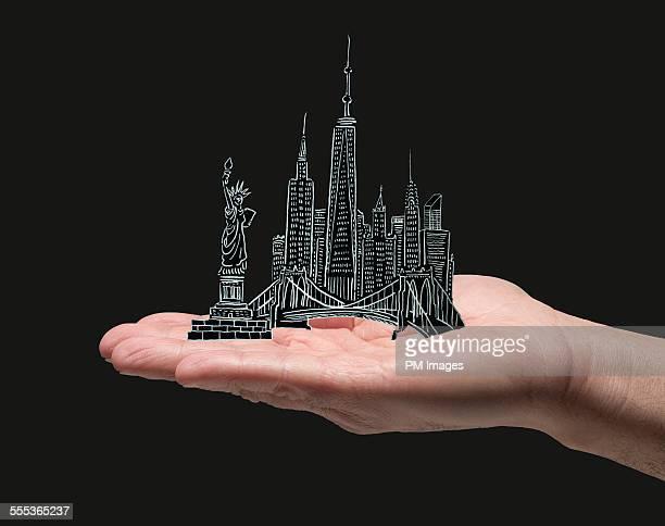 New York City in man's hand