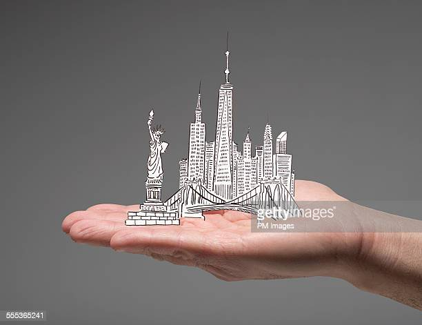 New York City in man's hand