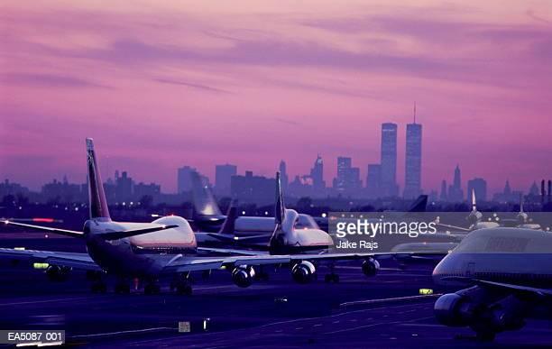 USA, New York City, JFK Airport, aircraft taxiing at sunset
